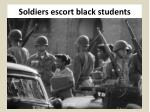 soldiers escort black students