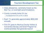 tourism development tax