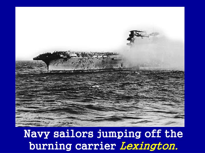 Navy sailors jumping off the burning carrier