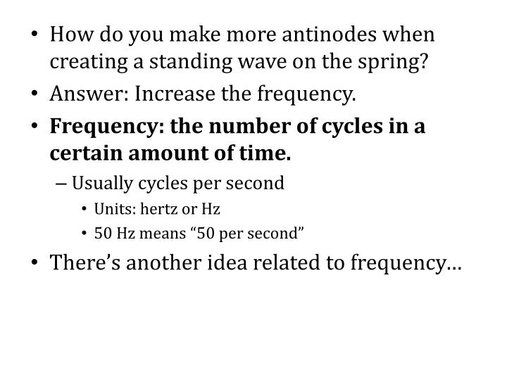 How do you make more antinodes when creating a standing wave on the spring?