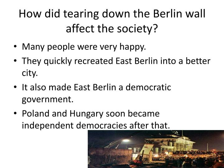 How did tearing down the berlin wall affect the society