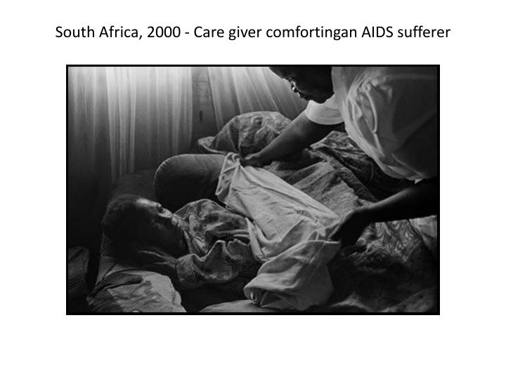 South Africa, 2000 - Care giver comfortingan AIDS sufferer