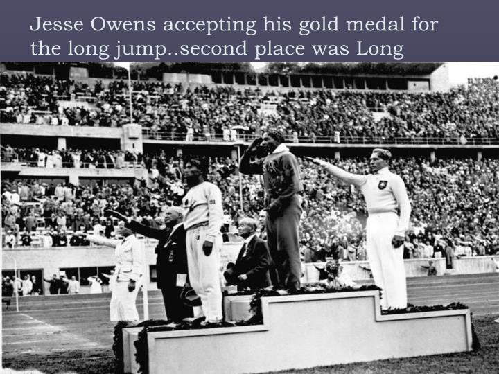 Jesse Owens accepting his gold medal for the long jump..second place was Long