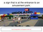 a sign that is at the entrance to an amusement park