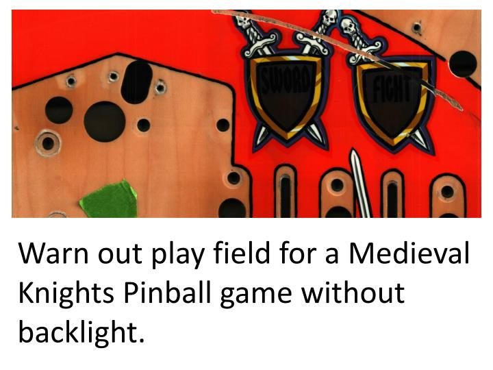 Warn out play field for a medieval knights pinball game without backlight