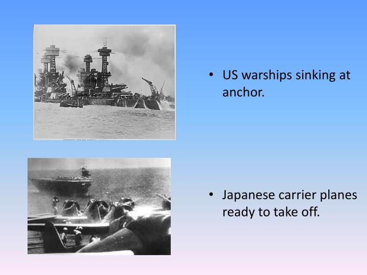 US warships sinking at anchor.