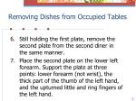 removing dishes from occupied tables3