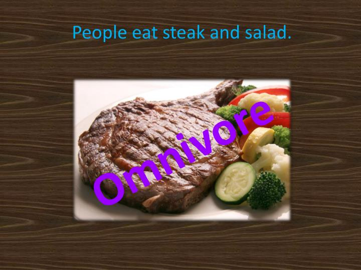 People eat steak and salad.