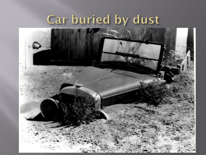 Car buried by dust