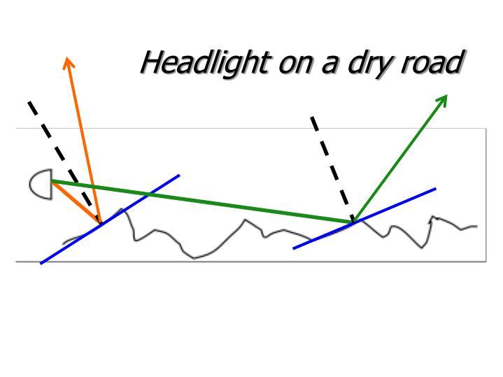 Headlight on a dry road