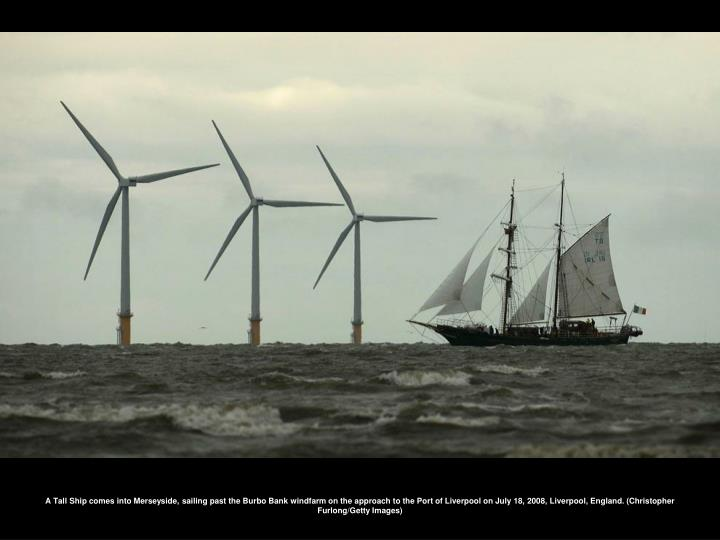 A Tall Ship comes into Merseyside, sailing past the Burbo Bank windfarm on the approach to the Port of Liverpool on July 18, 2008, Liverpool, England. (Christopher Furlong/Getty Images)