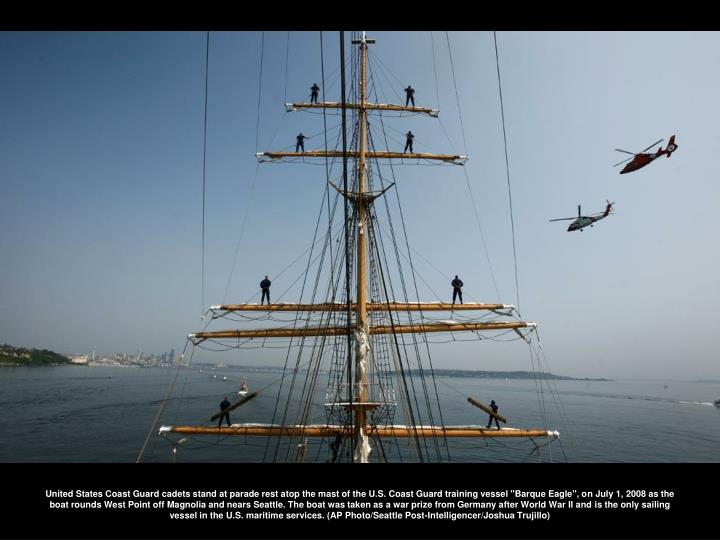 """United States Coast Guard cadets stand at parade rest atop the mast of the U.S. Coast Guard training vessel """"Barque Eagle"""", on July 1, 2008 as the boat rounds West Point off Magnolia and nears Seattle. The boat was taken as a war prize from Germany after World War II and is the only sailing vessel in the U.S. maritime services. (AP Photo/Seattle Post-Intelligencer/Joshua Trujillo)"""