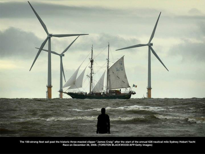 """The 100-strong fleet sail past the historic three-masted clipper """"James Craig"""" after the start of th..."""