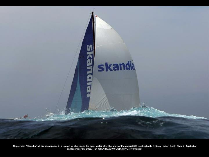 """Supermaxi """"Skandia"""" all but disappears in a trough as she heads for open water after the start of the annual 628 nautical mile Sydney Hobart Yacht Race in Australia on December 26, 2008. (TORSTEN BLACKWOOD/AFP/Getty Images)"""