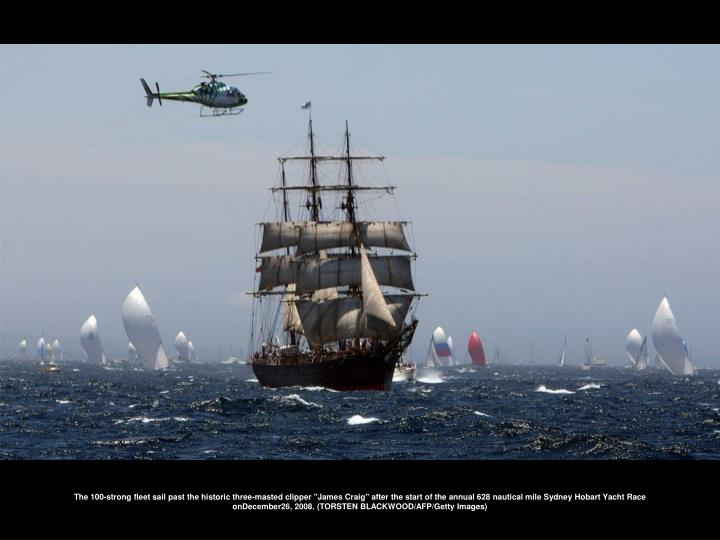 """The 100-strong fleet sail past the historic three-masted clipper """"James Craig"""" after the start of the annual 628 nautical mile Sydney Hobart Yacht Race onDecember26, 2008. (TORSTEN BLACKWOOD/AFP/Getty Images)"""