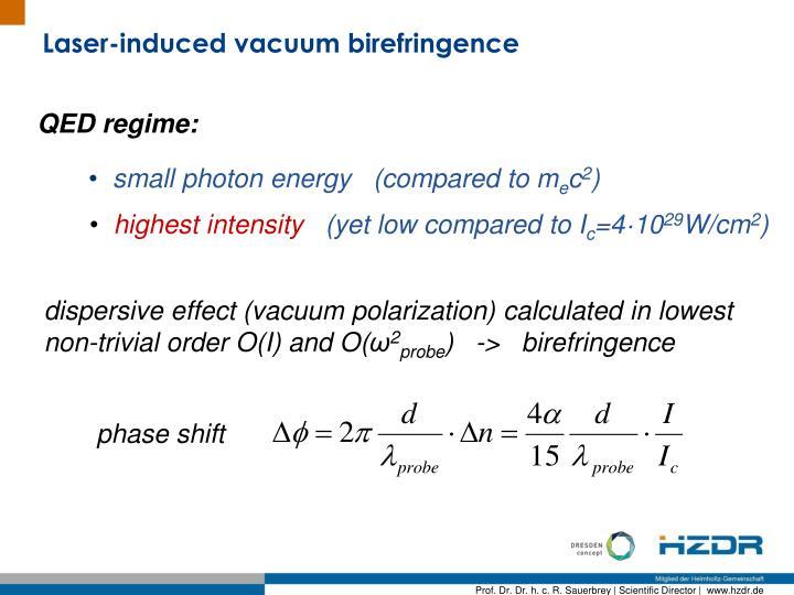 Laser-induced vacuum birefringence