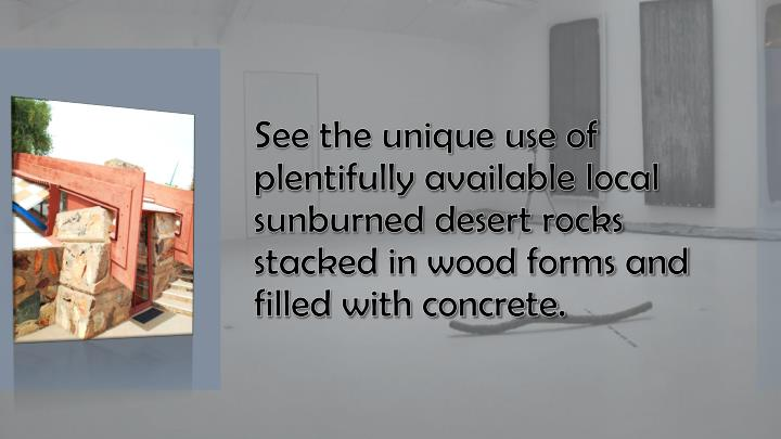 See the unique use of plentifully available local sunburned desert rocks stacked in wood forms and filled with concrete.