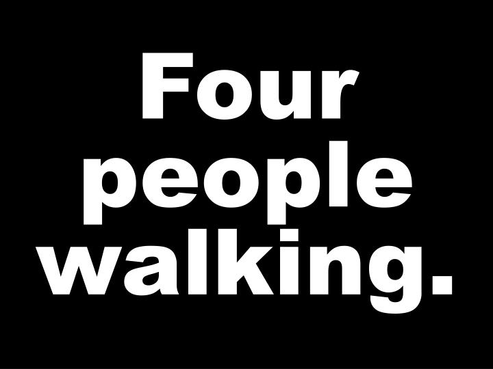 Four people walking.