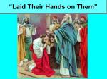 laid their hands on them