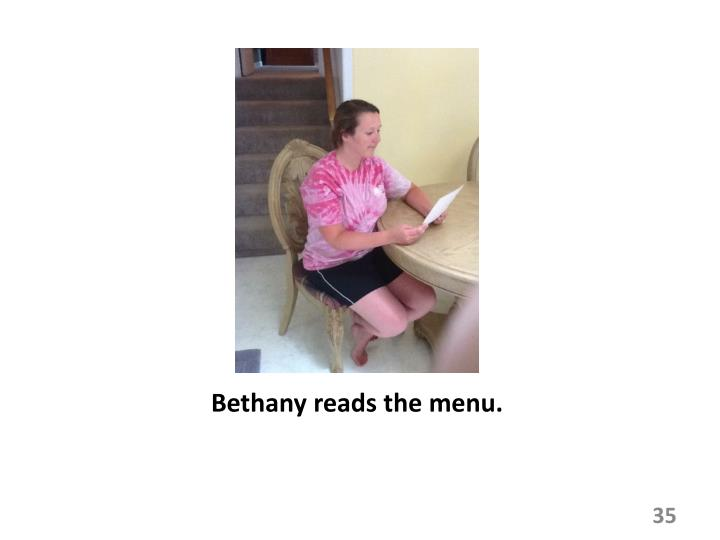 Bethany reads the menu.