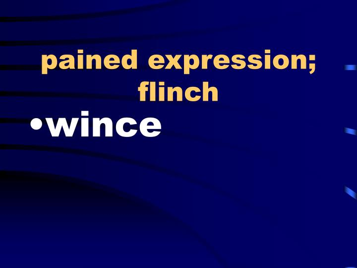 pained expression; flinch