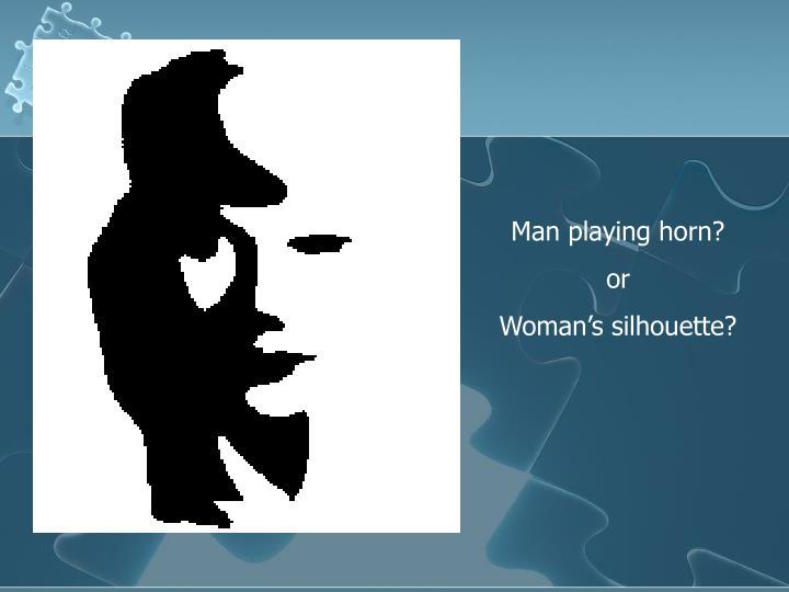 Man playing horn?