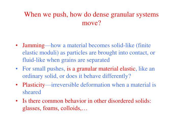 When we push, how do dense granular systems move?