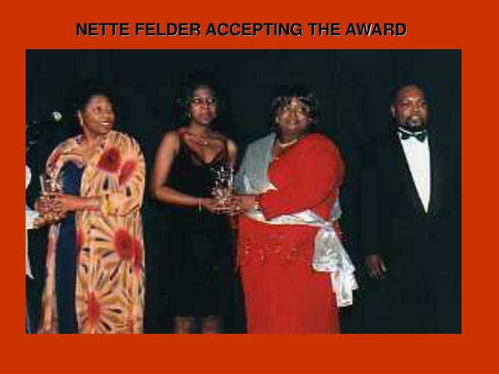 NETTE FELDER ACCEPTING THE AWARD
