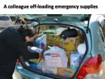 a colleague off loading emergency supplies