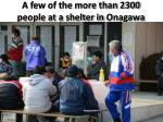 a few of the more than 2300 people at a shelter in onagawa