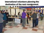 international volunteers planning the destination of the next consignment