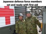 japanese defence force members set and ready with first aid