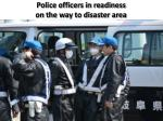 police officers in readiness on the way to disaster area