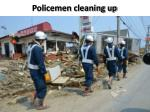 policemen cleaning up