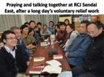 praying and talking together at rcj sendai east after a long day s voluntary relief work