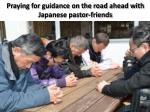 praying for guidance on the road ahead with japanese pastor friends