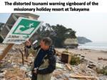 the distorted tsunami warning signboard of the missionary holiday resort at takayama