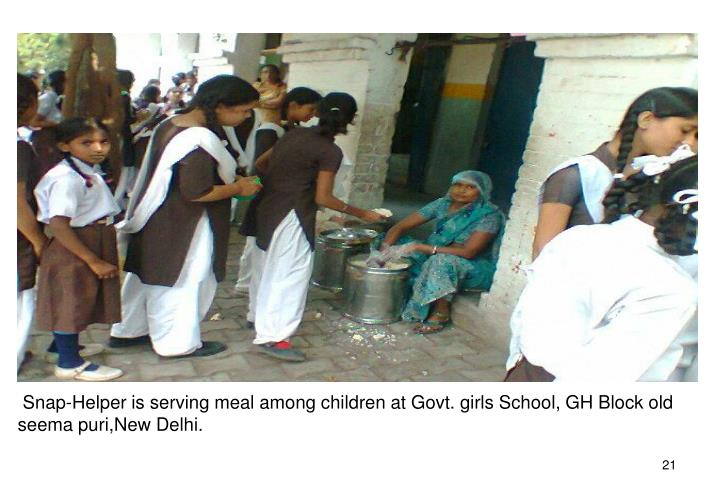 Snap-Helper is serving meal among children at Govt. girls School, GH Block old seema puri,New Delhi.