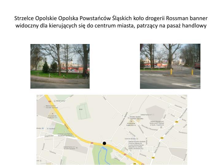 Strzelce Opolskie Opolska Powstańców Śląskich koło drogerii Rossman banner widoczny dla kierujących się do centrum miasta, patrzący na pasaż handlowy