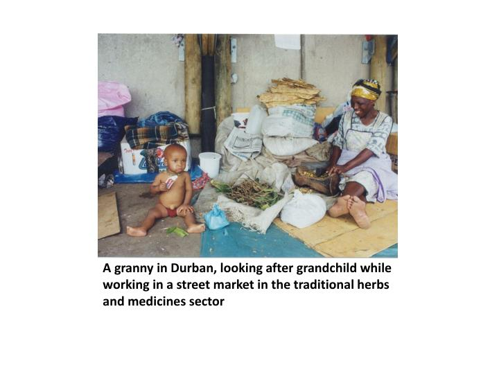 A granny in Durban, looking after grandchild while working in a street market in the traditional her...